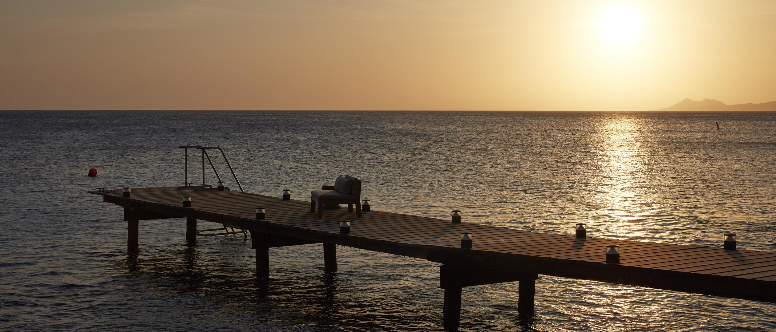 Sun setting over ocean at beach residence Bonaire
