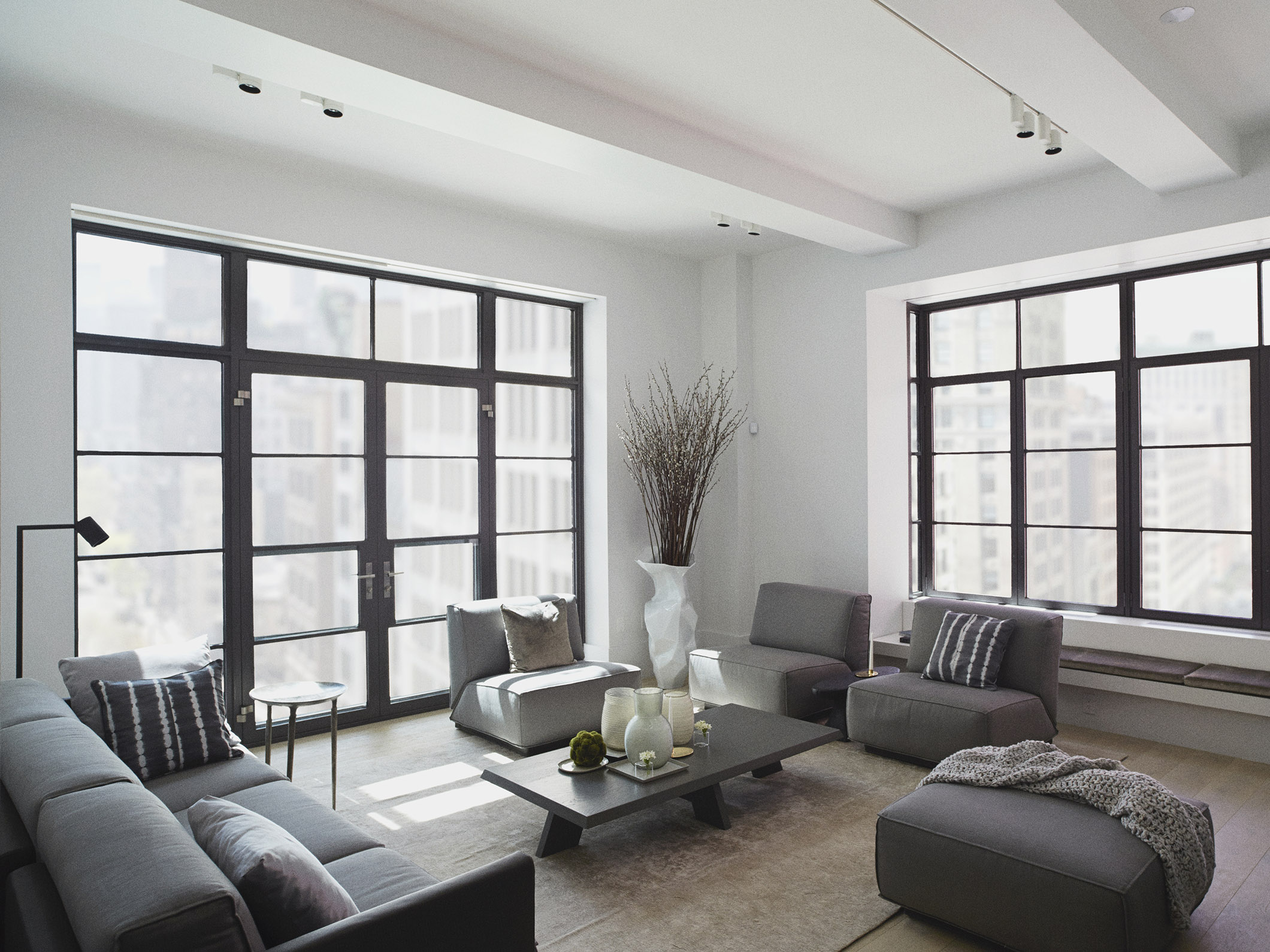 DOUTZEN sofa, armchair and pouf, ITSKE coffee table and Maretti tribe at Huys 404 model apartment