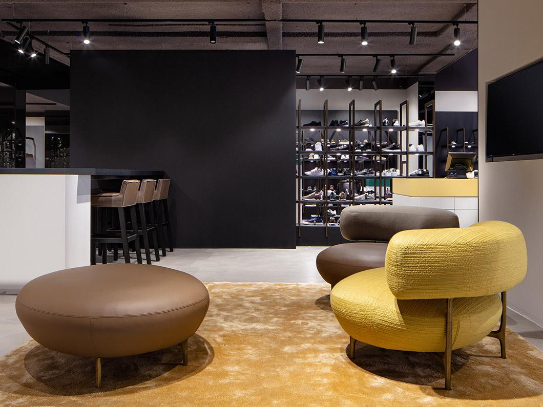 ELLA armchair & pouf and SAAR bar stool at Omoda Flagship Store in Amsterdam