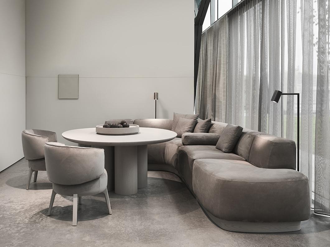 BO dining sofa, KOBE coffee table, HERO side table, KEKKE mirror, RISE carpet by Carpetlinq, TRIBE floor lamp by Maretti Lighting, VOLUMES vase by Serax