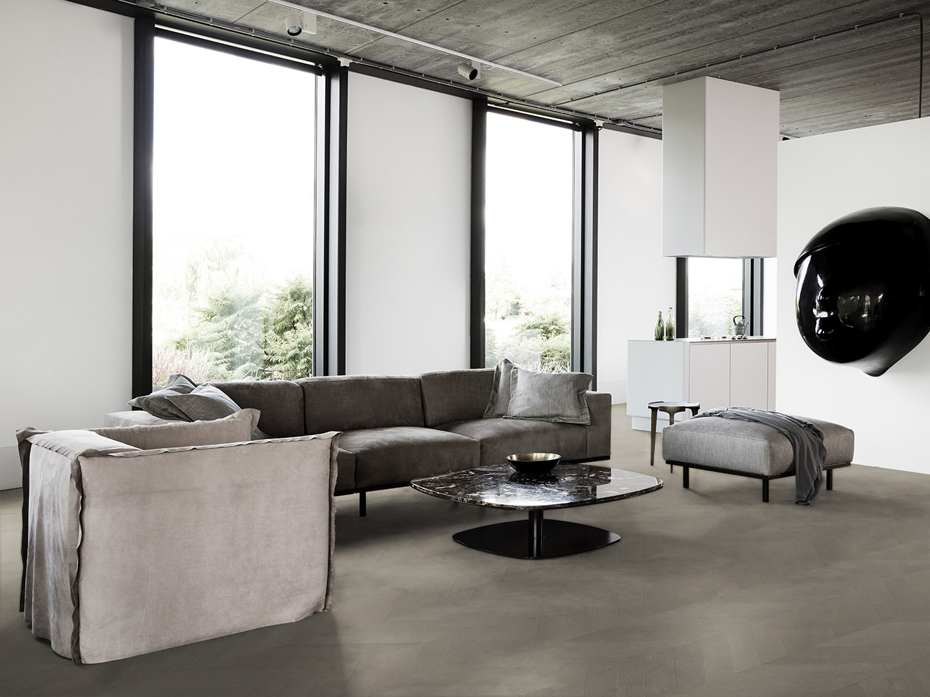Flooring by Solidfloor, DON sofa, FEDDE armchair and pouf and KEK coffee table at kitchen showroom