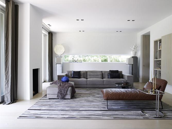 Rotterdam cubist villa with DIEKE sofa and pouf and KEKKE longchair, ITSKE coffee table, KLAAR lighting by Maretti and hardware ONE by Formani
