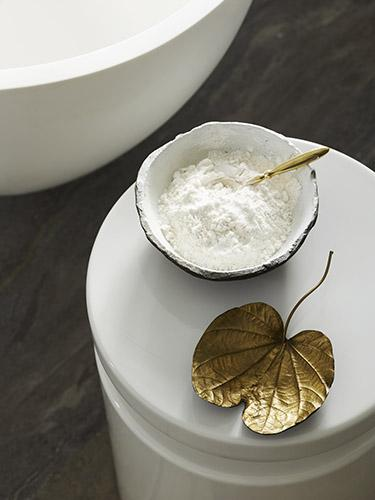 Bathroom styling with bath salt and leaf shaped saucer
