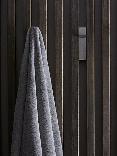 Wooden wall with hooks and towel