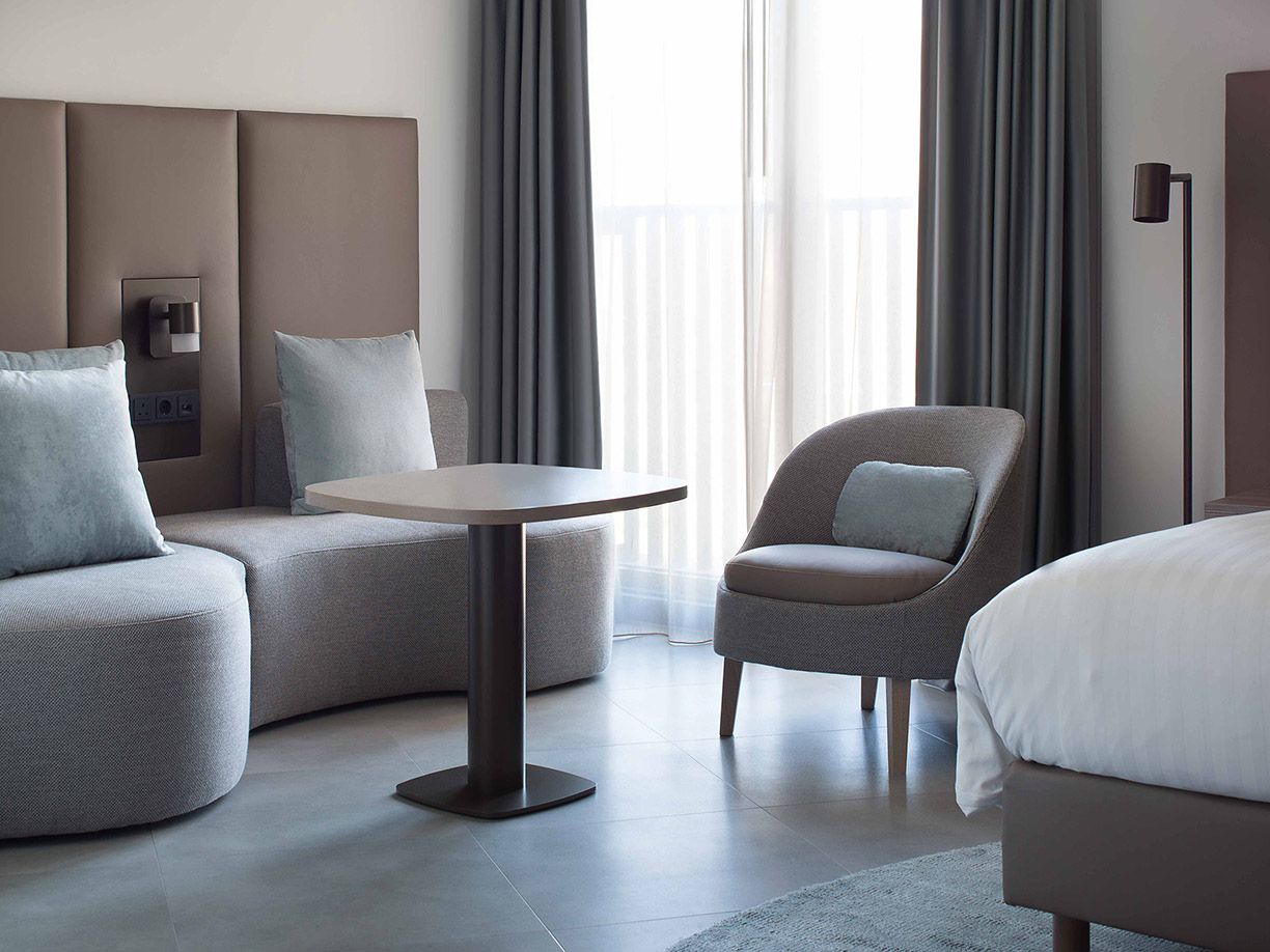 Marriott hotel Amsterdam with BELLE armchair and TRIBE lighting by Maretti