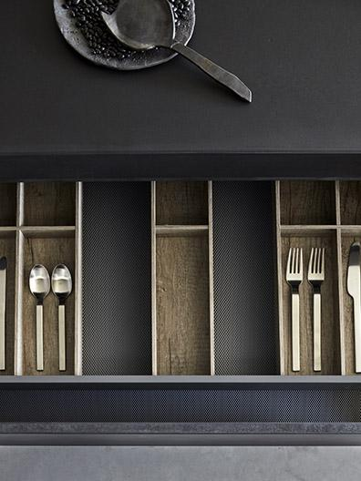 Matte black MASS kitchen finished with concrete with BASE cutlery by Serax