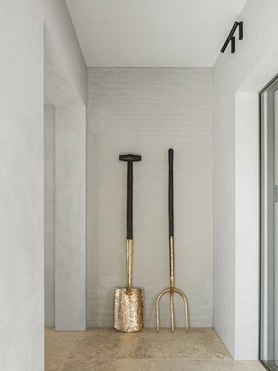 Gold and black fork and spade art in hallway at office in Brabant, Netherlands