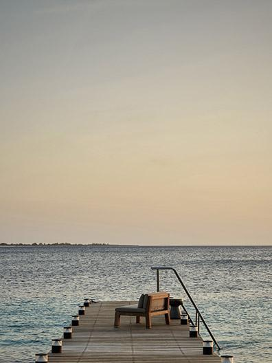 NIEK armchair on pier with sunset at beach residence on Bonaire