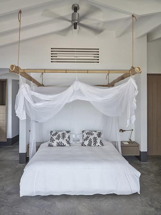 Bedroom with bed and mosquito net at beach villa on Bonaire