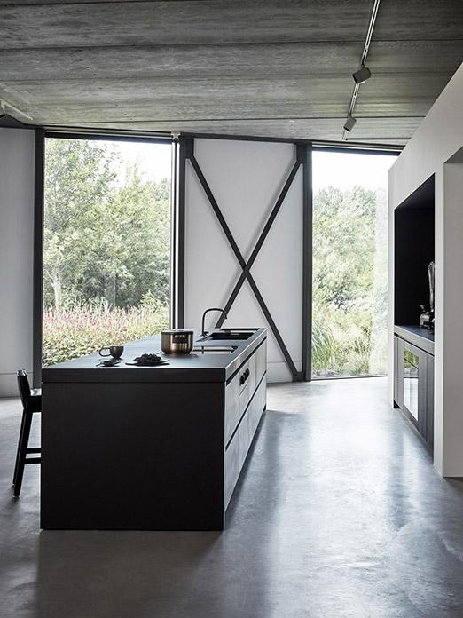 Matte black MASS kitchen finished with concrete with SAAR stool and Cocoon tap