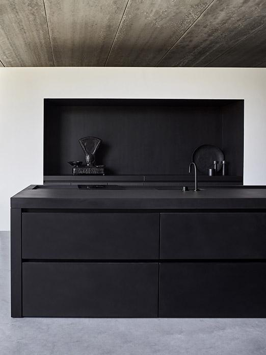 Matte black MASS kitchen finished with concrete with Cocoon tap