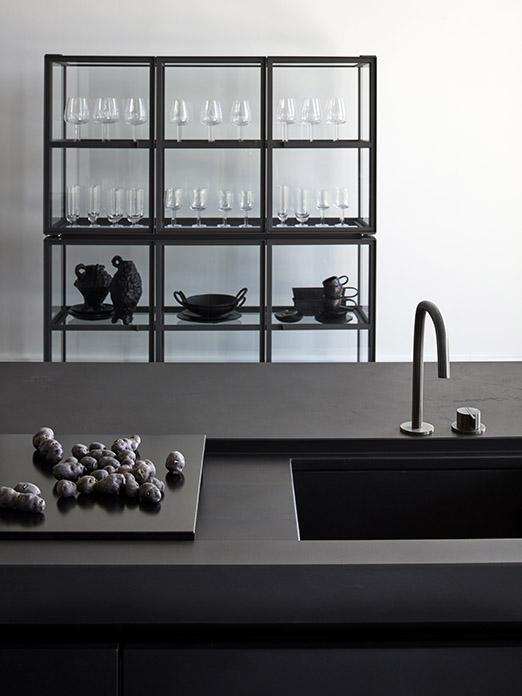Matte black MASS kitchen finished with concrete with FINN cabinet and Cocoon tap