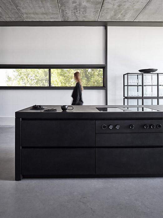 Matte black MASS kitchen finished with concrete with FINN cabinet