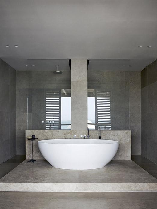 Bath tub with KLINK side table and Cocoon taps at luxury beach residence on Antigua